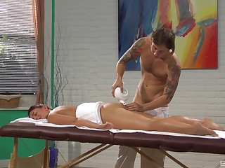 Mischa Brooks gets fucked on the table by her horny masseur during massage