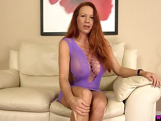 Ample breasted mature red head Faye Rampton is toying her esurient snatch