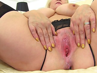 Blonde mature BBW Lacey Starr spreads their way pussy lips in stockings