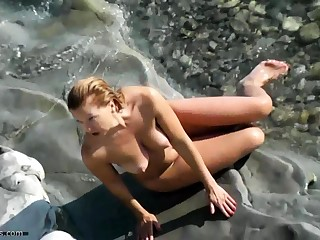Essential lovers caught on beach cams
