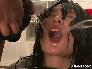 Submissive gagged Jap slut Aki Sasahara has to drink urine of studs