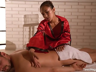 Raven haired Asian masseuse May Thai is poked in sideways pose